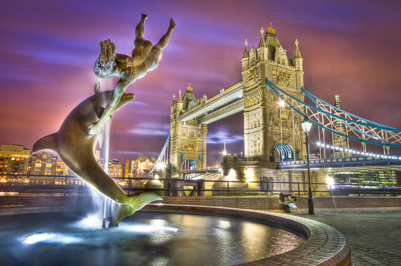 David Wynne's Girl With A Dolphin Statue in front of Tower Bridge in London